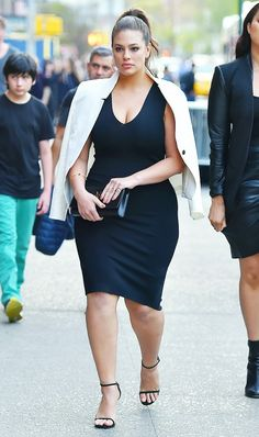 Dress down a polished bodycon dress and ankle strap heels ensemble with an effortless blazer tossed over your shoulders