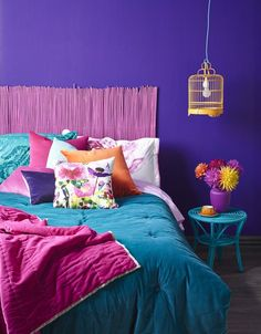 Rich saturated colour gives a jewel-like decadence to this bedroom. It uses Resene Pukeko walls, a Resene Smitten matchstick headboard, a Resene Flashback lighting shade (made from a bird cage), a Resene Centre Stage vase, and a Resene Seeker side table Mexican Bedroom, Interior Paint, Interior Design, Mexican Colors, Diy Furniture Decor, Purple Rooms, Pink Walls, Saturated Color, Light Colors