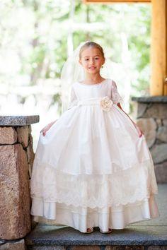 Elegant flower girl dress: http://www.stylemepretty.com/little-black-book-blog/2014/09/26/colorful-mountain-wedding-at-squaw-valley/ | Photography: Larissa Cleveland - http://www.larissacleveland.com/home