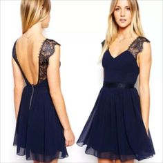 Party dress Beautiful navy dress. Never worn new with tags. It's pretty short so not for a tall person. Dresses
