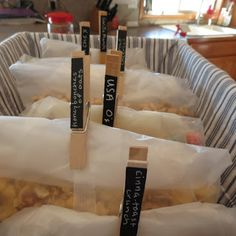Pantry organization and my cereal storage solution. DIY chalkboard clothes pins for labeling.