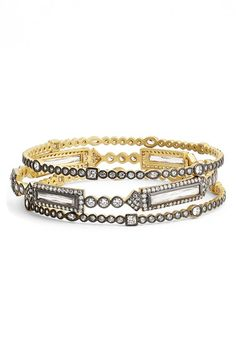 Free shipping and returns on Freida Rothman 'Metropolitan' Stackable Bangles (Set of 3) at Nordstrom.com. Satin-finish precious metal cast in a bold black-and-gold palette accentuates the watery bezel-set sparklers throughout this trio of stackable bangles.