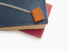 Personalized Books, Personalized Jewelry, Book Necklace, Book Jewelry, Leather Books, Orange Leather, Logo Stamp, Mini Books, Cufflinks