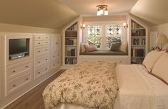 Traditional Guest Bedroom with Wall sconce, Window seat, Hardwood floors, flush light, Built-in bookshelf, High ceiling