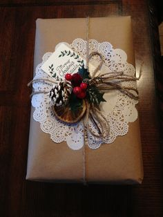 Christmas wrapping with brown paper and a doily