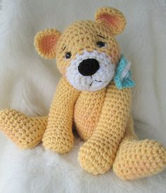 I love bears, so there always seems to be one in the making at my house. This sweet ted is about 16 inches tall from the top of his head to the bottom of his feet when you make him with two strands of worsted weight yarn held together. Pattern includes detailed instructions (in English), a materials list, and some helpful notes and hints to help you finished you teddy bear. Pattern includes instructions for both the bow and the flower. Make him or her in baby's nursery colors for a great…
