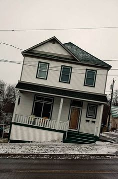 The Leaning Houses of Minnesota by Cameron Wittig
