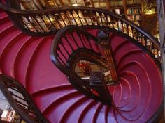 Lello Bookshop in Porto, Portugal - The glossy red staircase with carved wooden banisters leading to a glass atrium is the centerpiece of this bookstore, surely one of the most beautiful in the world. House Staircase, Grand Staircase, Staircase Design, Staircase Ideas, Luxury Staircase, Railing Ideas, Modern Staircase, Portugal, Grande Cage D'escalier