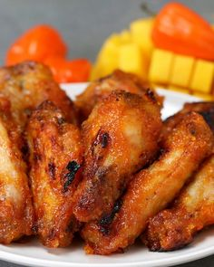 SPICY Mango Chicken Wings It's sweet and spicy in every bite. Cooking Chicken Wings, Chicken Wing Recipes, Baked Chicken, Crusted Chicken, Chicken Wing Sauces, Chicken Legs, Chicken Breasts, Trinidad Recipes, Trinidad Food