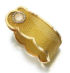 Wristwatch | Jaeger-LeCoultre.  Hinged basket weave cuff, applied with a circular cocktail watch framed with a border of brilliant-cut diamonds.  ca. 1960s