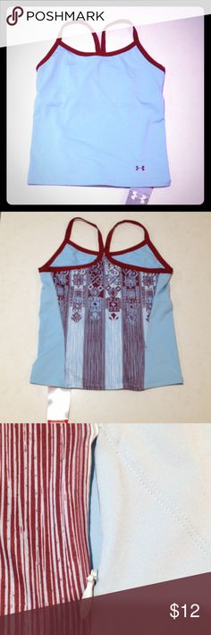 New Underarmour athletic top Under Armour workout top. Light blue with burgundy trim. Fun pattern on back that features a small zipper pouch. New with tags. Under Armour Tops Tank Tops