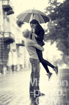 Photograph Young couple on the street of the city with umbrella by Vladimir…