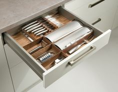 KNIFE ORGANISATION - Walnut and Steel drawer organisation for knives with foil & film dispensers. Also available in Beech & Birch.
