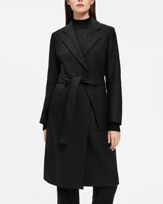 A timeless autumn investment made from traceable wool twill woven in Italy. Tailored belted coat, cut with narrow shoulders and slightly A-lined shape. Fully lined. <br><br> • Traceable mulesing-free wool from New Zealand<br> • Lightly A-line shaped