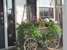 Old goat wagon repurposed into flower pot.  I love this look.  Now if I could just find some of these old wagons!