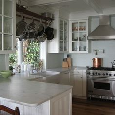 hanging pot rack over the sink | Mediterranean Home pot racks Design Ideas, Pictures, Remodel and Decor