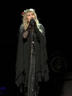and another photo of Stevie ~ ☆♥❤♥☆ ~ onstage wearing a crown of flowers during her '24 Karat Gold' US 2017 tour, in Charlottesville, VA on March 25th, 2017 ~ love her layered black outfit and gloves
