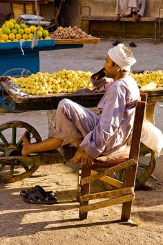 Market in Luxor, Egypt. Waiting for YOU to divulge in his hand picked fruits.