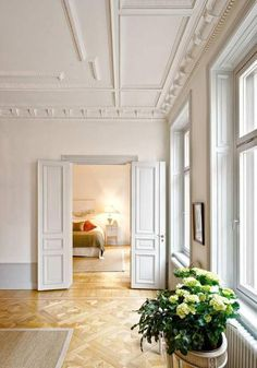 Love the crown molding and and French doors.