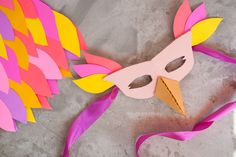 A colorful outfit and some scrap cardboard can go a long way to making a cute Halloween costume.