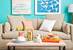 sofa and art pairing. Blue and orange with beige couch. One Kings Lane - The Relaxed Living Room. Painting by Jennifer Latimer.