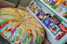 Made: Jelly Roll Floor Pillow..tutorial for pieced and appliqued intermediate quilting project, including those gutter shelves I love as bookshelves!