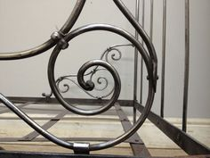 Beautiful simple scroll work on polished antique French daybed