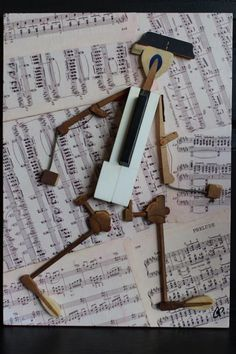 "Piche' Design, Rochester NY- whimsical use of old piano parts on background of vintage sheet music.  Facebook- ""Piche' Design- All custom creations"" for more info."