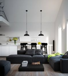 Modern Living Room with Dark Grey Sofa with Cusions and White Dining Table Set with Black Bar Stools and Hanging Pendant Lamps. My kind of living! :D