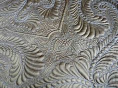 Worth looking at, gorgeous patterns and out of this world quilting.  silk wholecloth by fourseasonsquiltswap, via Flickr