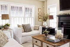 Like the mix of black and chippy white furniture.  Honeycomb Creative Co.: Vintage Home Tour