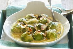 A perfect vegetable dish to serve at your next gathering, this simple veggie side dish has it all - tender veggies, a creamy cheddar cheese sauce and toasted nuts. Why wait? Try this Cheesy Brussels Sprouts recipe tonight!