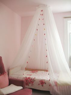 planning a DIY canopy like this for C's room. I was inspired by the pretty mosquito netting in Malawi summer of 2000...