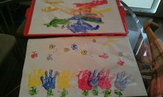 Handprint flowers with thumb print bees