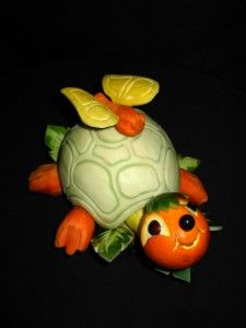 Tortise Butterfly Carving-The tortise/butterfly display is made with a combination of honey due melons, oranges, carrots, grapes, yellow squash, watermelon, and carrots.