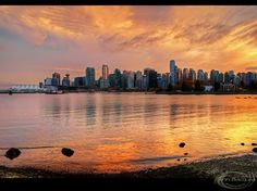 https://flic.kr/p/kXnEuW | Vancouver sunset | This is a view towards downtown Vancouver seen from the Stanley Park seawall just after sunset, British Columbia, Canada.   Processed in HDR  View Larger On Black   About this photo: I was going to go on a Friday to take some photos of the fall foliage in Stanley Park, but it was quite foggy and cloudy with some drizzle that day so I decided not to go.  I would wait until after the weekend as the forecast was calling for nicer weather.  Now it…