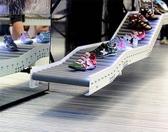 Shoes Displayed on Conveyor Belts - Commercial Interior Design News Commercial Architecture, Commercial Interior Design, Commercial Interiors, Belt Display, Shoe Display, Display Ideas, Roca Barcelona, Shoe Store Design, Shoe Shop