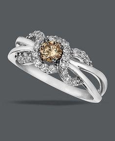 This ring will weave its way around your heart. A rich Chocolate Diamond® center with swirls of Vanilla Diamonds™ set in 14K Vanilla Gold™.