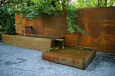Corten steel fountain in modern garden
