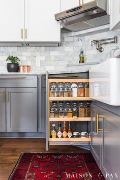 kitchen organization ideas: spice cabinet organizing... follow these 5 tips for a beautiful, functional kitchen! #kitchenorganization #organizing #spicecabinet #kitchendesign