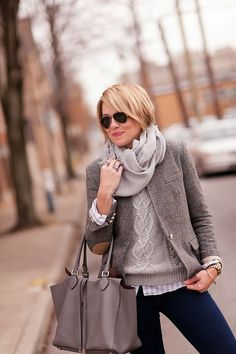 The gorgeousness of gray. Light taupe fisherman's sweater, slightly darker blazer, light gray oversized scarf and a tote toned to the blazer. Style Planet