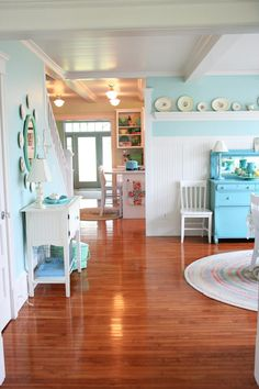 Aqua!  Love the beadboard and white/green accents.  Funny, the icy-turquoise hutch looks exactly like the hutch my parents had when I was a kid, but theirs wasn't purdy like this one.