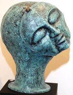 Cabeça em resina e fibra com pátina esverdeada '' máscara ''