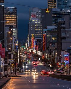 Granville Rain  It's quarter to six and near the end of rush hour. The rain soaked pavement reflects the lights of the Granville Mall. Captured from the Granville Street Bridge in Vancouver BC  February 10 2016
