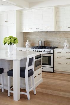 Kitchen cabinetry echoes the style of the shiplap walls for a seamless look. - Photo: Laura Moss / Design: Sandra Aromando