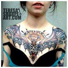 Awesome bat tattoo. I like the wingspan.
