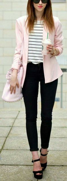 Black pants, black and white striped shirt, pink cardigan.