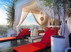 Love the bamboo in containers, red and wispy curtains....