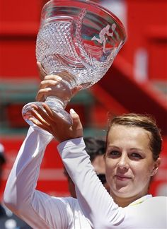 Anastasia Pavlyuchenkova, from Russia, lifts up her trophy during an award ceremony after winning the Portugal Open tennis tournament in Oeiras, outside Lisbon, Saturday, May 4, 2013. Pavlyuchenkova defeated Spanish Carla Suarez Navarro 7-5, 6-2. (AP Photo/Francisco Seco)