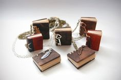 lovely. leather mini book necklaces.